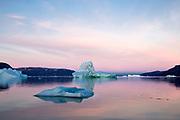 Iceberg in midnight sun, Ilulissat, Jakobshavn glacier, Disko Bay. Greenland