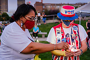 21 JULY 2020 - DES MOINES, IOWA: People light candles during a memorial and vigil for Congressman John Lewis (D-GA). About 300 people attended a vigil for the Representative Lewis in Poppajohn Sculpture Park in Des Moines Tuesday night. Rep. Lewis died from pancreatic cancer on July 17, 2020.           PHOTO BY JACK KURTZ