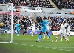 Tottenham Hotspur's Emmanuel Adebayor heads past Swansea City's Gerhard Tremmel to open the scoring - Photo mandatory by-line: Joe Meredith/JMP - Tel: Mobile: 07966 386802 19/01/2014 - SPORT - FOOTBALL - Liberty Stadium - Swansea - Swansea City v Tottenham Hotspur - Barclays Premier League