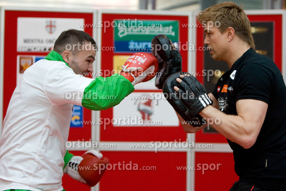 Boxer Dirk Dzemski, German coach (R) and Slovenian Boxer Dejan Zavec alias Jan Zaveck alias Mr. Simpatikus at open for public and press practice session before defending title of IBF World Champion, on April 6, 2010, in BTC City park, Ljubljana, Slovenia.  (Photo by Vid Ponikvar / Sportida)