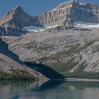 Portal Peak & Mount Thompson rise above Bow Lake in Banff National Park, Alberta, Canada.