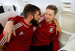 ZENICA, BOSNIA & HERZEGOVINA - Sunday, October 11, 2015: Wales' Joe Ledley and goalkeeper Wayne Hennessey on the team's return flight to Cardiff after qualifying for the UEFA Euro 2016 finals despite a 2-0 defeat to Bosnia and Herzegovina during the UEFA Euro 2016 qualifying match. (Pic by David Rawcliffe/Propaganda)