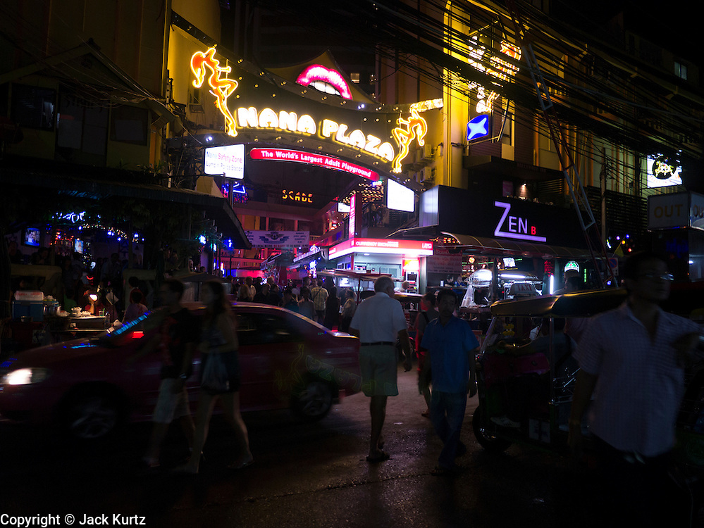 "05 JANUARY 2012 - BANGKOK, THAILAND: Entrance of the Nana Entertainment District, a warren of bars and brothels in central Bangkok. Prostitution in Thailand is technically illegal, although in practice it is tolerated and partly regulated. Prostitution is practiced openly throughout the country. The number of prostitutes is difficult to determine, estimates vary widely. Since the Vietnam War, Thailand has gained international notoriety among travelers from many countries as a sex tourism destination. One estimate published in 2003 placed the trade at US$ 4.3 billion per year or about three percent of the Thai economy. It has been suggested that at least 10% of tourist dollars may be spent on the sex trade. According to a 2001 report by the World Health Organisation: ""There are between 150,000 and 200,000 sex workers (in Thailand).""      PHOTO BY JACK KURTZ"