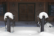 Snow-laden saddles outside western store