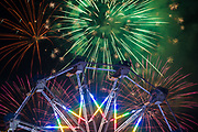 Fireworks explode as riders on the Ferris wheel receive a prime view to the show during the Stars and Stripes Fireworks Festival at Rancho Santa Susana Community Park in Simi Valley on July 4, 2017.