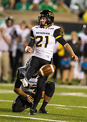 Oct 9, 2015; Huntington, WV, USA; Southern Miss Golden Eagles place kicker Parker Shaunfield watches as his field goal is blocked during the second quarter against the Marshall Thundering Herd at Joan C. Edwards Stadium. Mandatory Credit: Ben Queen-USA TODAY Sports