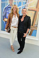 MELISSA ODABASH and JULIEN MACDONALD at a private view in aid of Chickenshed of Julian Schnabel's first UK solo show of paintings for 15 years entitled 'Every Angel Has A Dark Side' held at the Dairy Art Centre, 7a Wakefield Street, Bloomsbury, London on 24th April 2014.