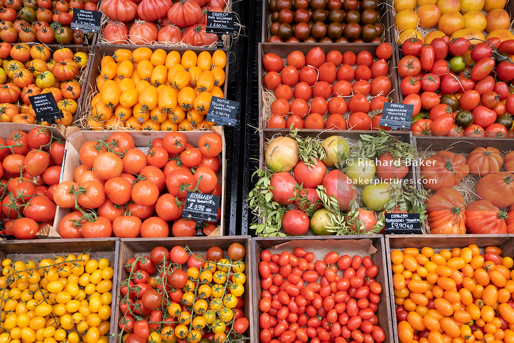 Local grocer 'Bora & Sons', a fruit and veg retailer, displays many varieties of tomatoes frpm Italy, France, the Netherlands, and England outside its high street business on Lordship Lane in East Dulwich, on 25th October 2021, in London, England.