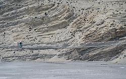 THEMENBILD - Trekkingtour in Nepal um die Annapurna Gebirgskette im Himalaya Gebirge. Das Bild wurde im Zuge einer 210 Kilometer langen Wanderung im Annapurna Gebiet zwischen 01. September 2012 und 15. September 2012 aufgenommen. im Bild eine Frau geht über eine Hängebrücke im Mustang // THEME IMAGE FEATURE - Trekking in Nepal around Annapurna massif at himalaya mountain range. The image was taken between september 1. 2012 and september 15. 2012. Picture shows woman at swing bridge at Mustang, NEP, EXPA Pictures © 2012, PhotoCredit: EXPA/ M. Gruber