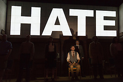 """© Licensed to London News Pictures. 08/05/2014. London, England. Pictured: Sam Crane as Winston and Tim Dutton as O'Brien during the Two Minutes Hate. The Play """"1984"""" by George Orwell transfers to the Playhouse Theatre until 19 July 2014. A new adaptation for the stage by Robert Icke and Duncan MacMillan. With Sam Crane as Winston Smith. Photo credit: Bettina Strenske/LNP"""