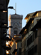 Architectural street detail from Florence, Italy. Showing the distant tower of the Battistero di San Giovanni.