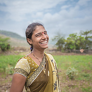 INDIVIDUAL(S) PHOTOGRAPHED: Sonali Tulpule. LOCATION: Ahirwade, Maharashtra, India. CAPTION: Sonali pauses for a moment while tending to a small plot of land on her family's farm. While many people across India are heavily dependent on chemical fertilisers, Sonali and her family are able to use bio-slurry, a by-product from the biogas unit they recently had installed by Sistema Biobolsa. This simple technology ferments organic waste and turns it into methane gas, which the family is then able to use instead of firewood for cooking.