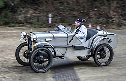 © Licensed to London News Pictures. 28/01/2018. Weybridge, UK. Competitor Olly Sanders drives a 1929 Austin 7 Ulster at Brooklands Museum as he takes part in The Vintage Sports-Car Club's New Year driving tests round the historic motor racing circuit. Photo credit: Peter Macdiarmid/LNP