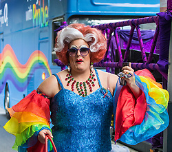 London, July 8th 2017. Thousands of LGBT+ revellers take part in the annual Pride in London parade under the banner #LoveHappensHere. PICTURED: Drag queen Betty Lush makes her way towards her group.