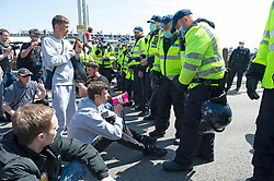 © Licensed to London News Pictures 29/05/2021. Dover, UK. Protesters block the A20 road. Anti-immigration protest in Dover. Demonstrators marching through Dover in Kent today in protest against immigration and the amount of migrants crossing the English Channel in small boats. Photo credit:Grant Falvey/LNP