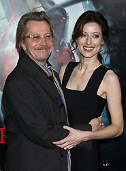 Gary Oldman, wife, Donya Fiorentino, Red Riding Hood, Film Premiere, Grauman's Chinese Theatre, (Hollywood, CA.)