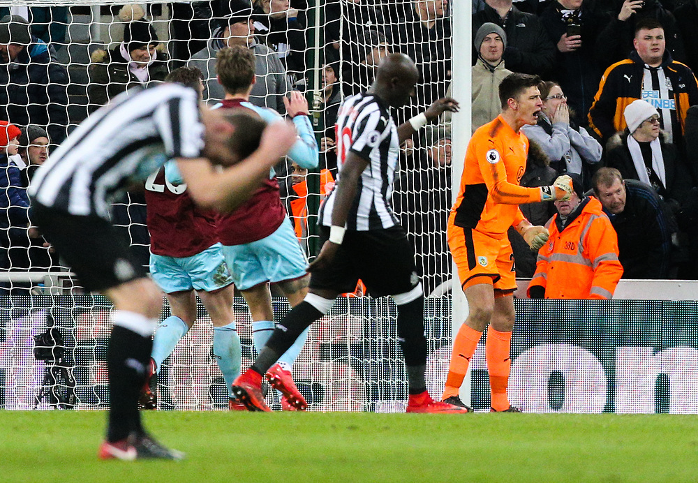 Burnley's Nick Pope celebrates after saving the penalty from Newcastle United's Joselu<br /> <br /> Photographer Alex Dodd/CameraSport<br /> <br /> The Premier League - Newcastle United v Burnley - Wednesday 31st January 2018 - St James' Park - Newcastle<br /> <br /> World Copyright © 2018 CameraSport. All rights reserved. 43 Linden Ave. Countesthorpe. Leicester. England. LE8 5PG - Tel: +44 (0) 116 277 4147 - admin@camerasport.com - www.camerasport.com