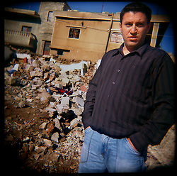 Hassan Al-Akhrass visits the site where his family members were killed in the war between Israel and Hezbollah, Aytaroun, Southern Lebanon, Oct. 23, 2006.