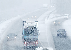 Heavy Snowfall in West Lothian, Wednesday, 4th April 2018<br /> <br /> More heavy snow fell in West Lothian this afternoon causing traffic problems for drivers on the M8 Edinburgh to Glasgow motorway<br /> <br /> Alex Todd   EEm