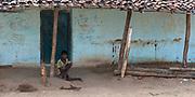 A handicapped boy outside his house close to Tamnara, Madhya Pradesh, India.