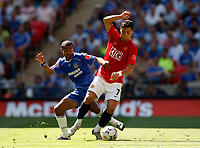 Photo: Richard Lane/Sportsbeat Images.<br />Manchester United v Chelsea. FA Community Shield. 05/08/2007. <br />United's Christiano Ronaldo is challenged by Chelsea's Ashley Cole.