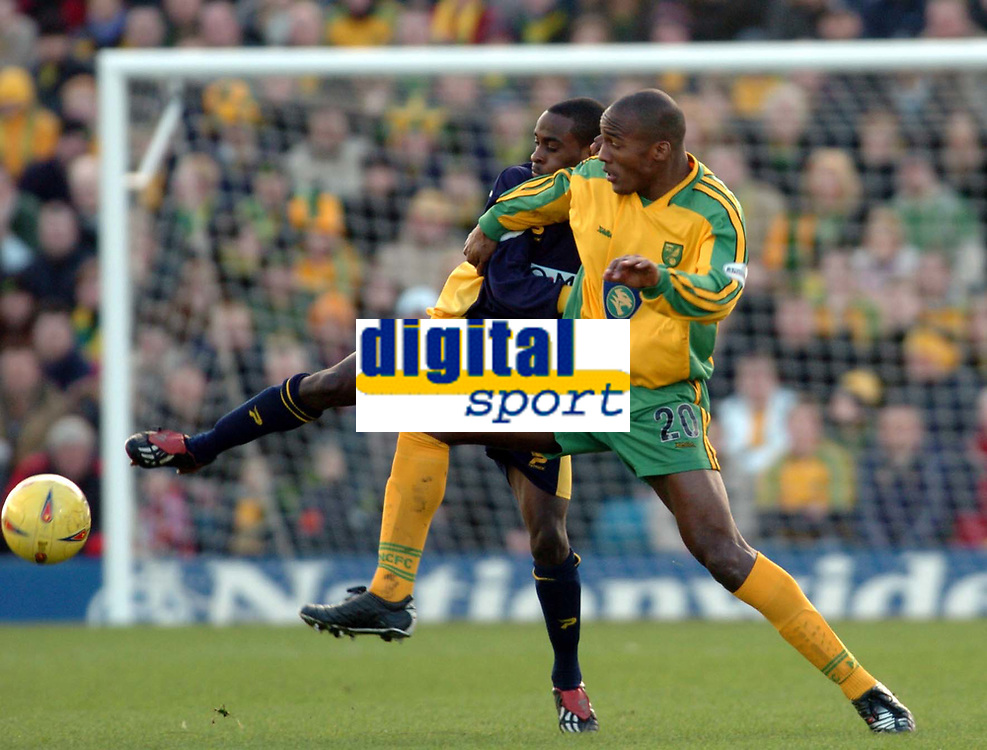Picture: Henry Browne.<br />Date: 07/02/2004.<br />Wimbledon v Norwich City.<br /><br />Damien Francis of Norwich tussles with Jamal Campbell Ryce of Dons.
