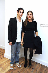 ALEX DELLAL and CHARLOTTE CASIRAGHI daughter of Princess Caroline of Monoco at the inaugural exhibition at the Yvon Lambert London Gallery featuring work ny Mexican born artist Carlos Amorales, 20 Hoxton Square, London N1 on 16th October 2008.