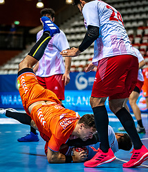 The Dutch handball player Dani Baijens, Alp Eren Pektas in action during the European Championship qualifying match against Turkey in the Topsport Center Almere.