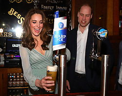 The Duchess of Cambridge pulls a pint with the Duke of Cambridge during their visit to Belfast Empire Hall for an informal party to celebrate inspirational young people who are making a real difference in Northern Ireland as part of their two day visit to Northern Ireland.