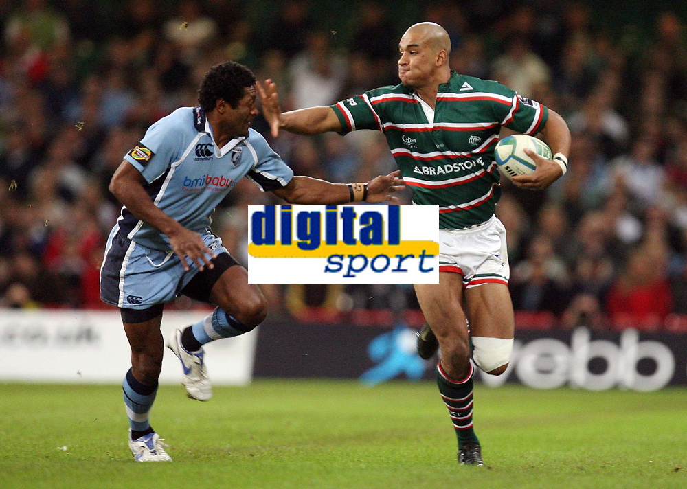 Photo: Rich Eaton.<br /> <br /> Cardiff Blues v Leicester Tigers. Heineken Cup. 29/10/2006. Mosese Luveitasau of Cardiff Blues left gets a hand off from Tom Varndell of Leicester