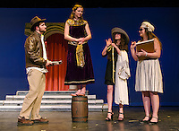 """Phil Bennet (Tom Pouliot) talks with Louise Goldman (Kayla Zarella) while she gets measured by Cochette (Kara Langathianos) and her assistant played by Melissa Moynihan during dress rehearsal for """"Epic Proportions"""" at Gilford High School Monday afternoon.  (Karen Bobotas/for the Laconia Daily Sun)"""
