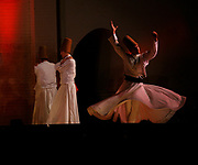 A Sufi whirling dervish during a rare, public ceremonial performance at the Bab Makina in Fes, Morocco during the annual Fes Festival of World Sacred Music on Monday, June 04, 2007. The festival is in the first week of June and has been a huge attraction for the city for thirteen years. These performers were from Turkey and practice Sufism, a sect that has evolved from Islam. (PHOTO BY TIMOTHY D. BURDICK)