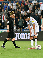 Football - 2021 / 2022  EFL Sky Bet Championship - Swansea City vs Millwall - Liberty Stadium - Wednesday 15th September 2021<br /> <br /> Jay Fulton Swansea City looks down at the end of the match, referee Mr John Busby   in background<br /> <br /> COLORSPORT/WINSTON BYNORTH