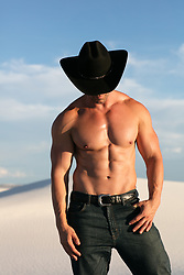 muscular shirtless cowboy with a great body outdoors