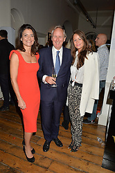 Left to right, ELIZABETH OFFORD, CHARLIE MAYHEW and LEXI BOWES LYON at a private view of photographs by renowned wildlife photographer David Yarrow in aid of TUSK entitled 'Wild Encounters' held at Somerset House on 19th September 2016.