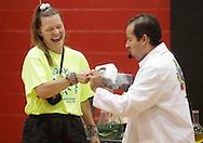 Middletown, New York - Erik Maldonado, right, reacts after a spoon held by a  counselor made funny noise when held against a block of dry ice during a Mad Science demonstration at the YMCA summer camp on August 20, 2010.
