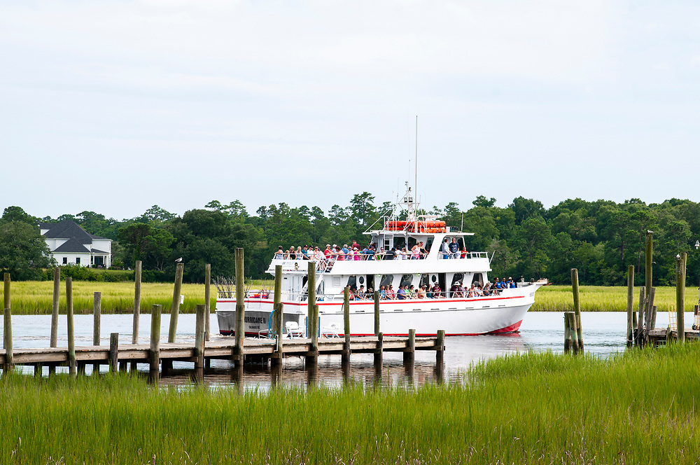 A tour boat departs on the Calabash River in Calabash, North Carolina on Thursday, August 5, 2021. Copyright 2021 Jason Barnette