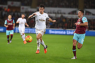 Jack Cork of Swansea city breaks past Aaron Cresswell of West Ham Utd. Barclays Premier league match, Swansea city v West Ham Utd at the Liberty Stadium in Swansea, South Wales  on Sunday 20th December 2015.<br /> pic by  Andrew Orchard, Andrew Orchard sports photography.