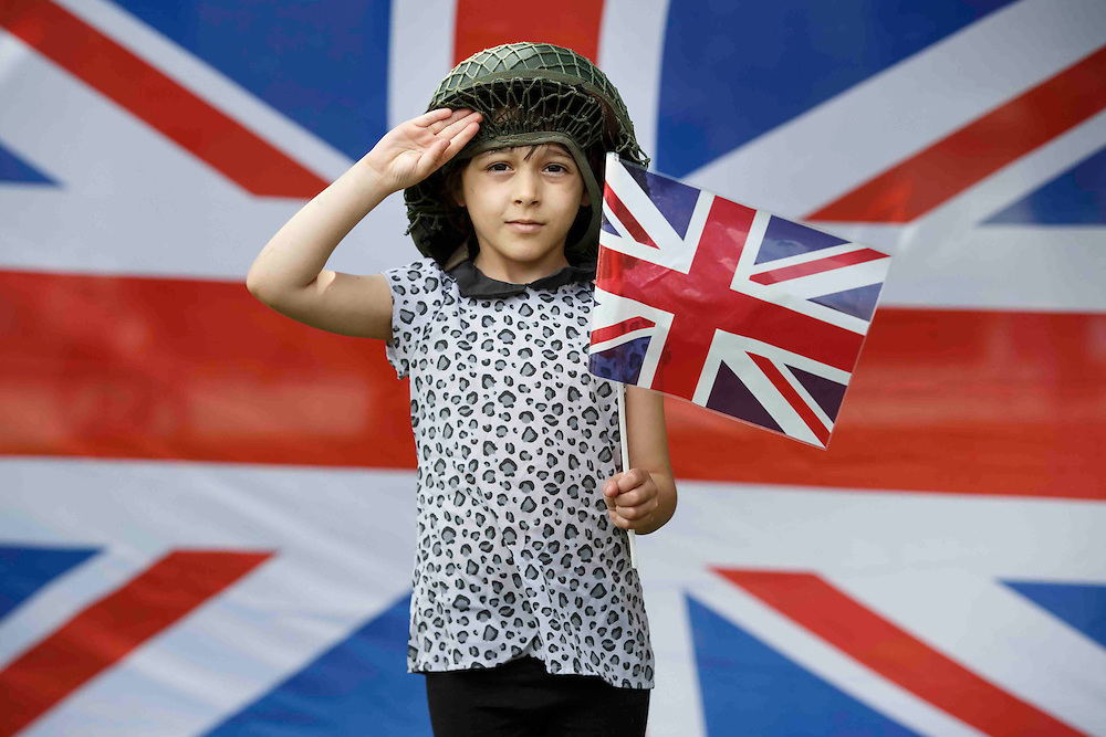 Armed Forces Day 2015.  Ava McDade (5) from Glasgow enjoys the celebrations. Glasgow. Picture Robert Perry 27th June 2015<br /> <br /> Must credit photo to Robert Perry<br /> FEE PAYABLE FOR REPRO USE<br /> FEE PAYABLE FOR ALL INTERNET USE<br /> www.robertperry.co.uk<br /> NB -This image is not to be distributed without the prior consent of the copyright holder.<br /> in using this image you agree to abide by terms and conditions as stated in this caption.<br /> All monies payable to Robert Perry<br /> <br /> (PLEASE DO NOT REMOVE THIS CAPTION)<br /> This image is intended for Editorial use (e.g. news). Any commercial or promotional use requires additional clearance. <br /> Copyright 2014 All rights protected.<br /> first use only<br /> contact details<br /> Robert Perry     <br /> 07702 631 477<br /> robertperryphotos@gmail.com<br /> no internet usage without prior consent.         <br /> Robert Perry reserves the right to pursue unauthorised use of this image . If you violate my intellectual property you may be liable for  damages, loss of income, and profits you derive from the use of this image.