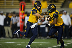 California quarterback Chase Garbers (7) hands off to running back Damien Moore (28) during the second quarter of an NCAA college football game, Saturday, Sept. 4, 2021, in Berkeley, Calif. (AP Photo/D. Ross Cameron)