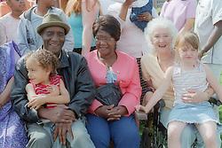Grandchildren sitting on grandparents' knees,