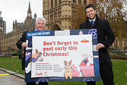 ROYAL MAIL: Former Postie Scott Mann MP (Conservative, North Cornwall), right, and former Parcelforce driver Hugh Gaffney MP (Labour Coatbridge) urge members of the public to post their letters and cards early for Christmas. London, November 28 2018.