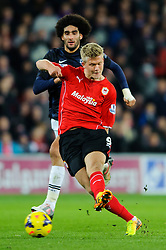 Cardiff Forward Andreas Cornelius (DEN) has a shot as Man Utd Midfielder Marouane Fellaini (BEL) challenges him during the second half of the match - Photo mandatory by-line: Rogan Thomson/JMP - Tel: Mobile: 07966 386802 - 24/11/2013 - SPORT - FOOTBALL - Cardiff City Stadium - Cardiff City v Manchester United - Barclays Premier League.