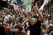 Angered by the recent series of assasination, Palestinians chant slogans during the funeral of the second Hamas leader, Abdel Aziz Rantisi. Rantisi was assasinated by Israelis on April 17, 2004.