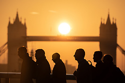October 10, 2018 - London, London, UK - London, UK. The sun rises through Tower Bridge in London, as the capital expects unseasonably warm weather later in the day, with temperatures set to reach up to 23 degrees Celsius. (Credit Image: © Tom Nicholson/London News Pictures via ZUMA Wire)
