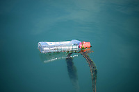 clear plastic bottle being used as a mooring Buoy