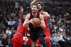 December 4, 2017 - Chicago, IL, USA - Cleveland Cavaliers forward Kevin Love (0) drives past Chicago Bulls guard Kris Dunn (32) and Chicago Bulls center Robin Lopez (42) during the second half on Monday Dec. 4, 2017 at the United Center in Chicago, Ill. (Credit Image: © Armando L. Sanchez/TNS via ZUMA Wire)