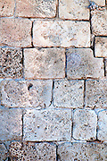 Close up of a wall constructed with Kurkar a calcareous sandstone or fossilized sea sand dunes common in Israel