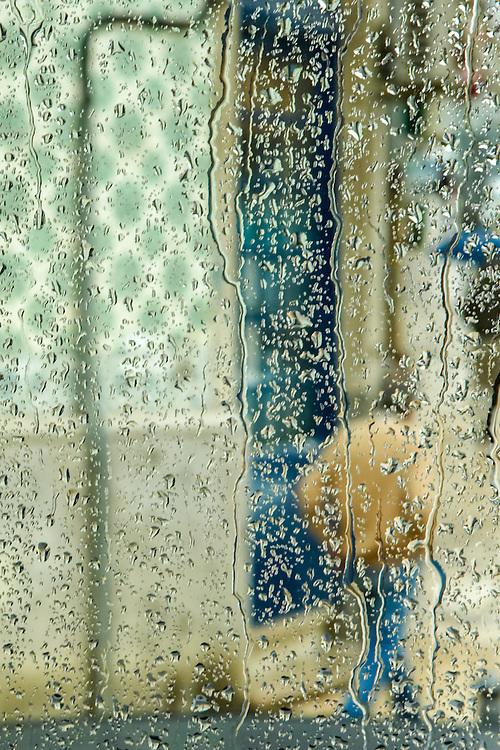 through a bus window in rainy Lisbon