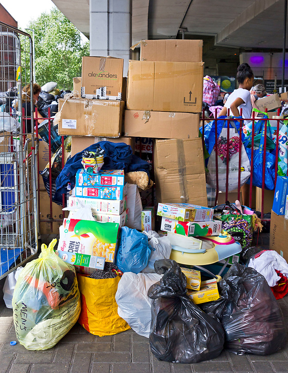 15 June 2017 taken between the hours of 12.12 - 14.41<br /> <br /> Chaotic scenes underneath the Westway flyover. Donations had been poring in non stop here for about 24 hours. Volunteers sorted them into men, women and children - boxed them up and loaded them on to awaiting vans.  However the vans had nowhere to take them. Warehouse space was desperately needed.<br /> Before long none of the local community centres had capacity to take any more donations.